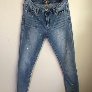 Lucky Brand Brooke Skinny splatter paint jeans.